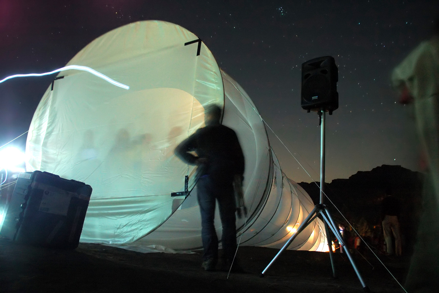 The sock houses a projector and ends with a rear-projection screen