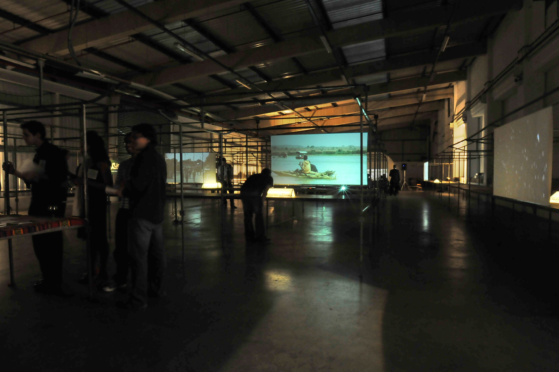 Market stalls transformed into cinema screens — Photo: Andrew Tam