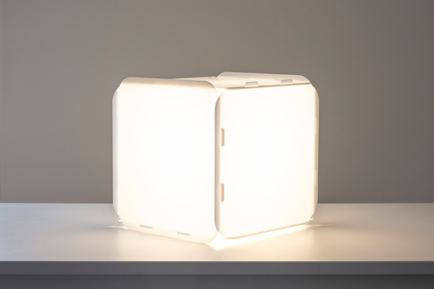 White cubic lamp with the light on