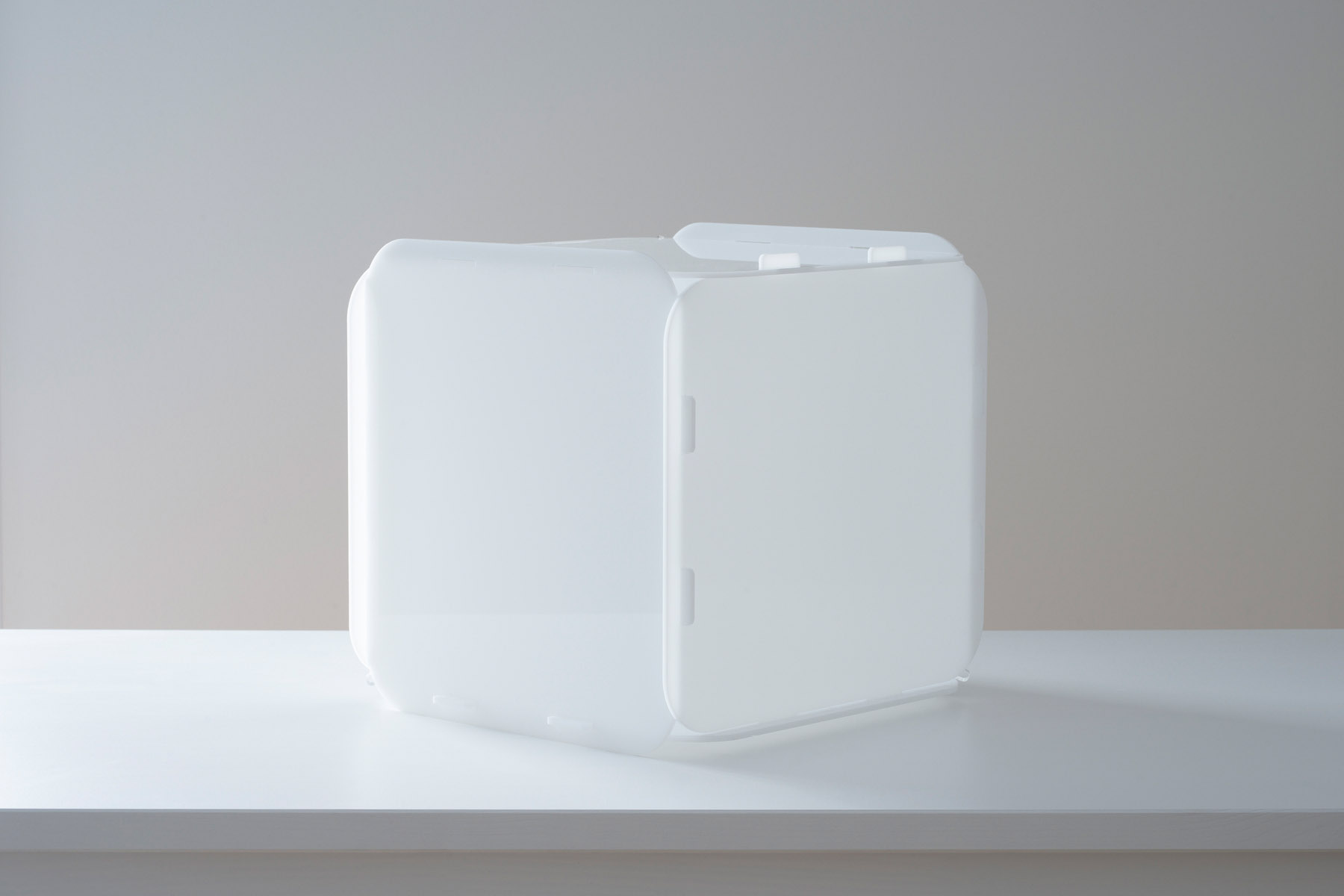 White cubic lamp with the light off