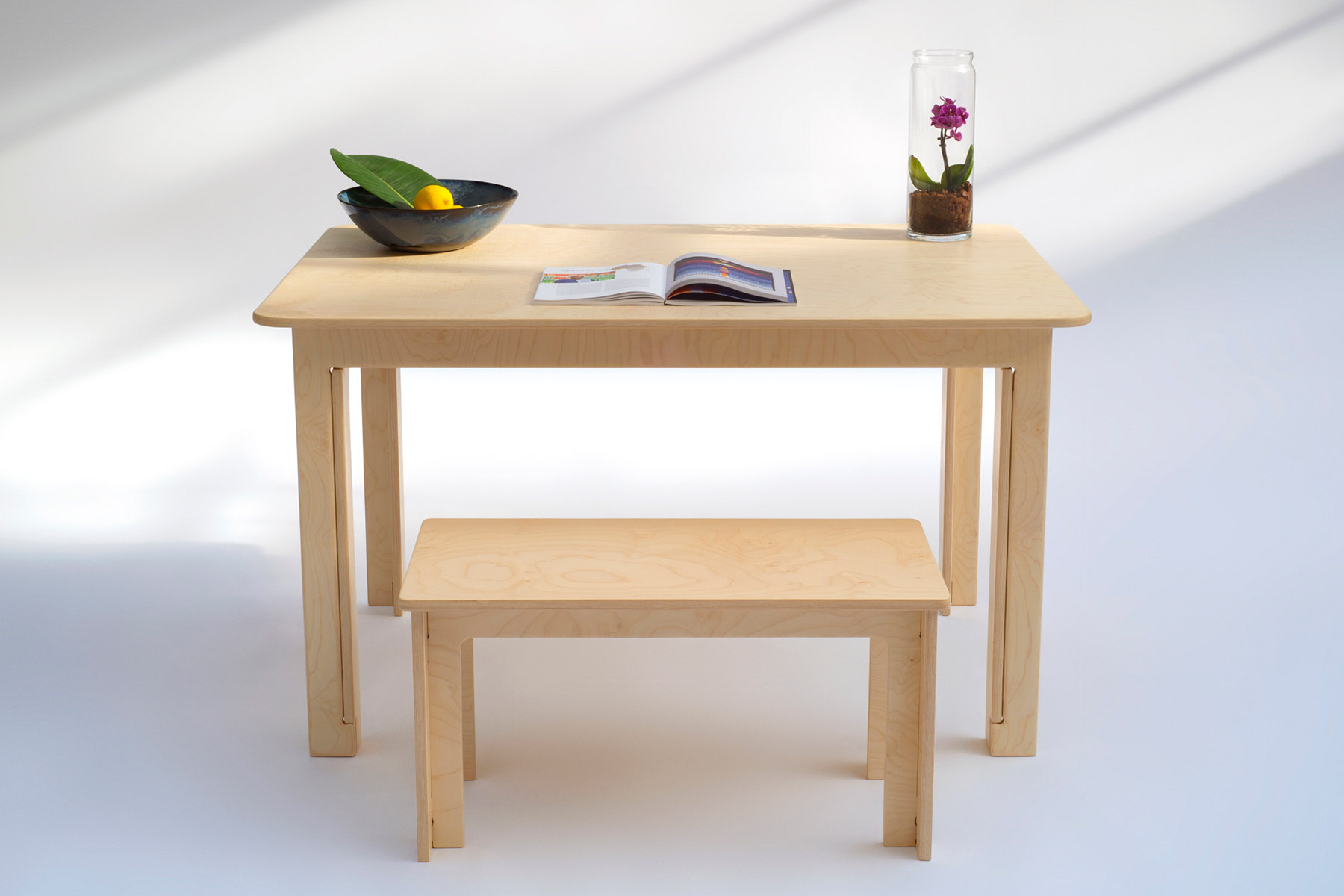 Table used as desk, with coffee table (sold separately) as bench