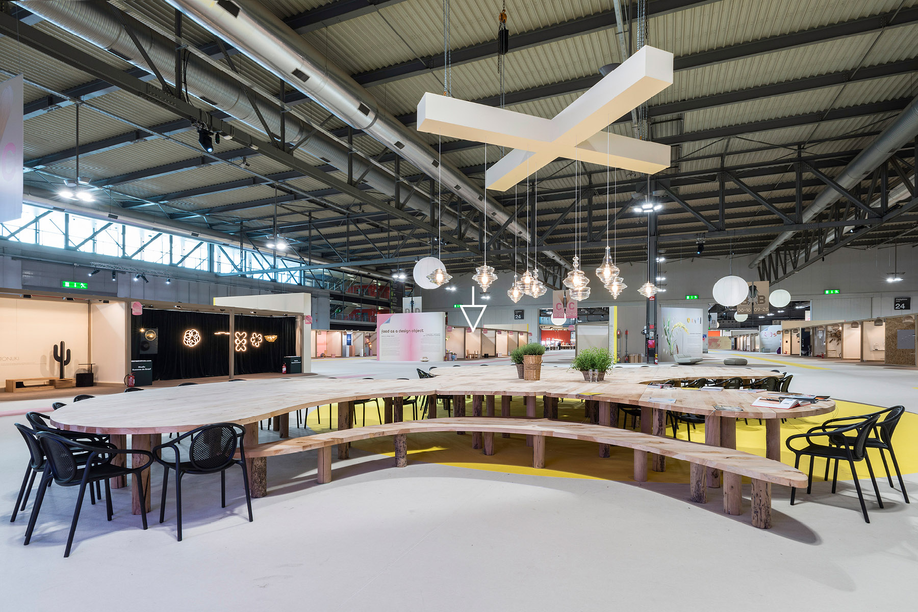 Overview of the SaloneSatellite 2019 exhibition, with an arrow above Jflemay's kiosk